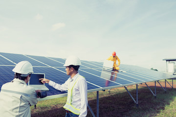 Team engineers checking solar cells. Solar cells have been maintained and maintenance by a team of engineers.