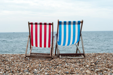 Red And Blue Deckchair On Beach