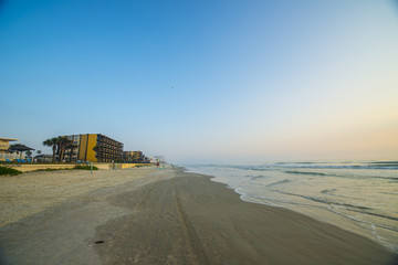Daytona Beach sunrise with low tide on beach and hotels