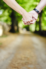 Couple holding their hands while have a walk