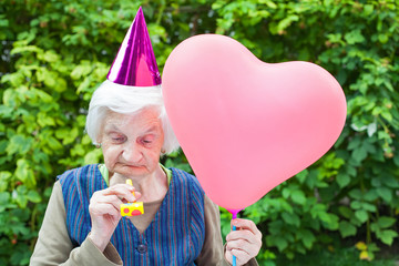 Elderly woman celebrating birthday