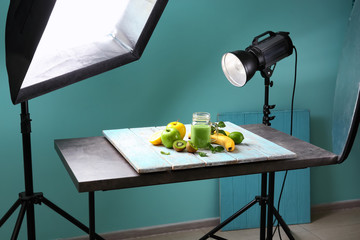 Professional equipment and juice in photo studio. Concept of food photography