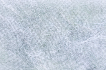Close-up of an abstract white gauze background texture.