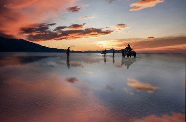 Sunset at lake Salar de Uyuni in Bolivia