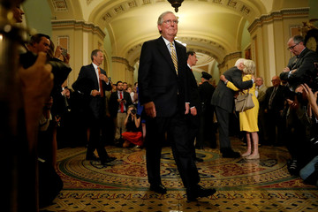 Senate Majority Leader Mitch McConnell arrives to speak with reporters following the successful vote to open debate on a health care bill on Capitol Hill in Washington