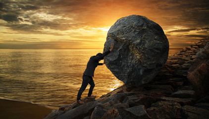 Business man pushing large stone up to hill , Business heavy tasks and problems concept. Wall mural