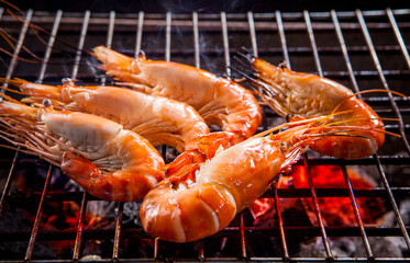 shrimp ,prawns grilled on barbecue fire stove