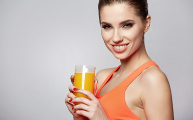 Beautiful woman holding a glass of orange juice. Healthy diet