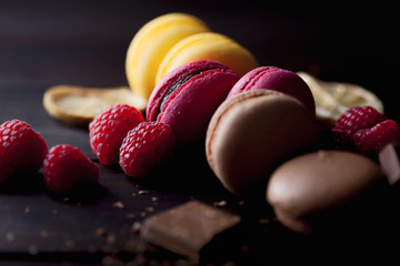 Spoed Foto op Canvas Macarons Group of colorful macarons with their ingredients over a wooden table