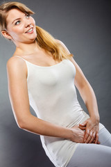 woman with hands holding her crotch