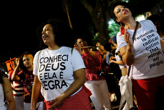 Demonstrators dance during a protest by black and indigenous women against racism and machismo in Sao Paulo