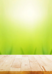 Wood table top on nature abstract green bokeh background