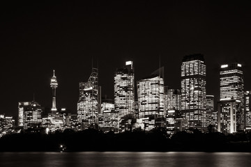 Beautiful illuminated Sydney Skyline at night in black and white