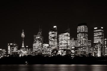 Beautiful illuminated Sydney Skyline at night in black and white