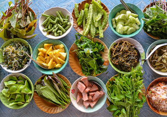 Variety of  local vegetables having with curry rice noodle (Thai Southern style)