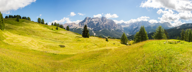 Poster Hill Meadows at high altitudes forming gentle hills. Dolomites, Alta Badia, Sud Tirol, Italy