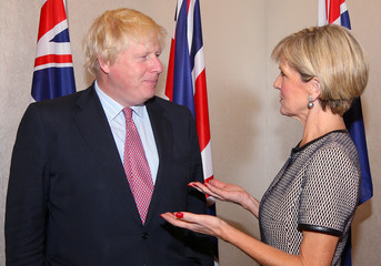 British Foreign Secretary Boris Johnson talks with Australian Foreign Minister Julie Bishop before the start of their bilateral meeting in Sydney, Australia