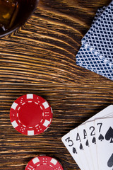 On a wooden table, money for the game and a combination of playing cards