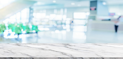Empty White marble table top view with blurred patient at hospital background,Mock up template for display or montage of your design,Banner for advertise of product,panorama view