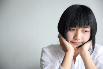 Asian young woman thinking and looking portrait in coffee shop cafe