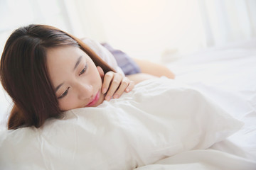Asian girl with japanese school girl uniform on bed room
