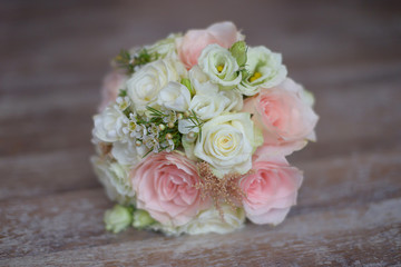 Pastel bridal round bouquet with pink and white roses. Floral arrangement ideas for the bride and bridesmaids