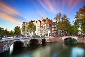 Beautiful sunset at the Emperors canal (Keizersgracht) and Leidse canal in Amsterdam in spring