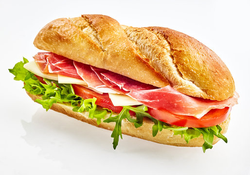 Baguette sandwich with serrano ham, cheese and vegetables