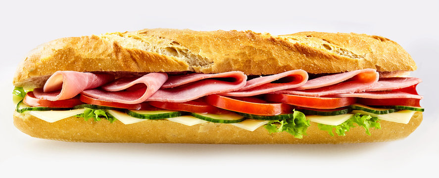 Tasty fresh baguette sandwich with baked ham