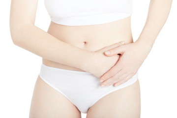 Woman with abdominal pain isolated on white, clipping path