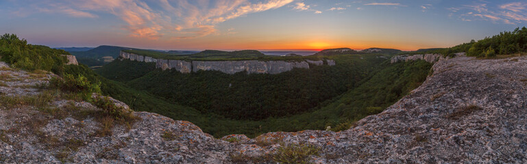 View from the Kyz-Kermen plateau to the slope of an adjacent plateau in the Crimean mountains at sunset