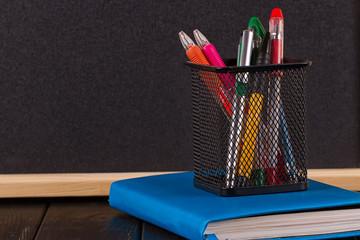 Stationery: pens, pen holder, diary