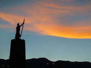 Tupac Amaru statue against sunset in Cusco, Peru