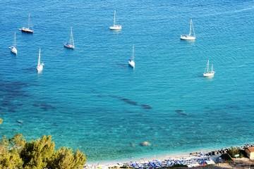 turquoise water and white beach at taormina