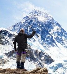 Mount Everest from Kala Patthar and tourist with ice axe