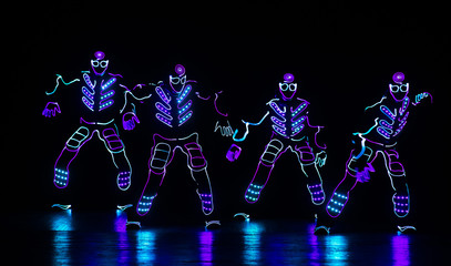 dance team in costumes of the LEDs
