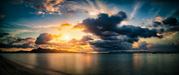 Sunrise over sea panoramic. Alcudia, Mallorca island, Spain.