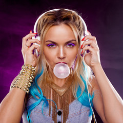 Young fashionable girl in disco style Blowing bubble from gum. Retro style