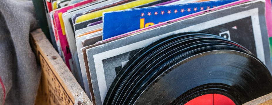 garage sale display of LPs and vinyls for music collectors