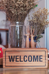 Welcome sign on wooden board.