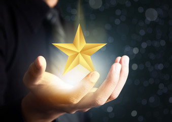businessman holding excellence star