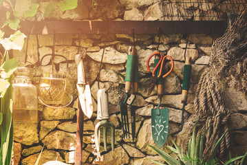 Still Life Farmer Agricultural Tools Hanging on the Wall - Vintage Tone Home Decoration Background