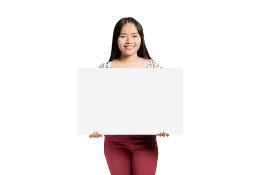 portrait of a beautiful asian woman smiling and holding a blank label in the hands. Isolated on white background with copy space and clipping path