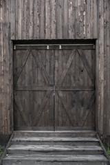 Countryside aged old farm barn gates closeup