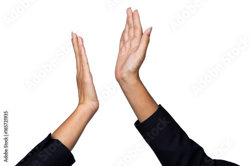 businesswoman giving hi five or touching hands for celebration