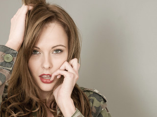 Sexy Portrait Of A Woman Wearing an Army or Military Camouflage Casual Jacket