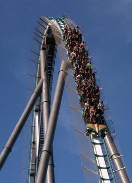 People ride in the 'Shambhala' roller coaster at PortAventura resort, south of Barcelona