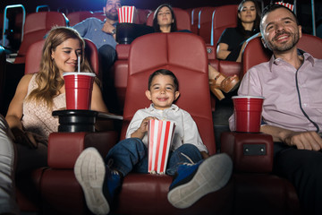 Little boy in the movies with his family