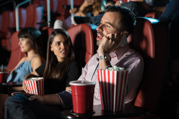 Disrespectful man in a movie theater