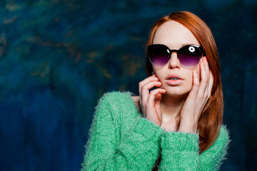 young beautiful redhead woman in sunglasses